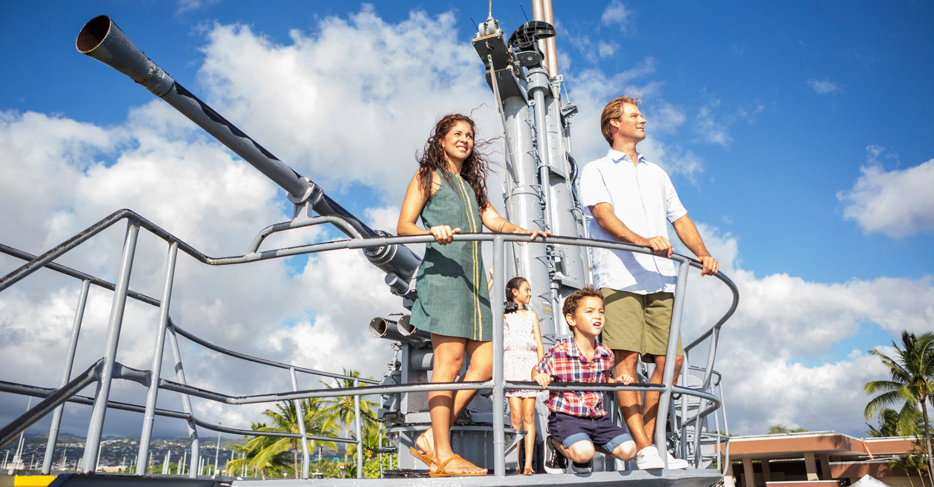 Family looks out from Bowfin deck gun