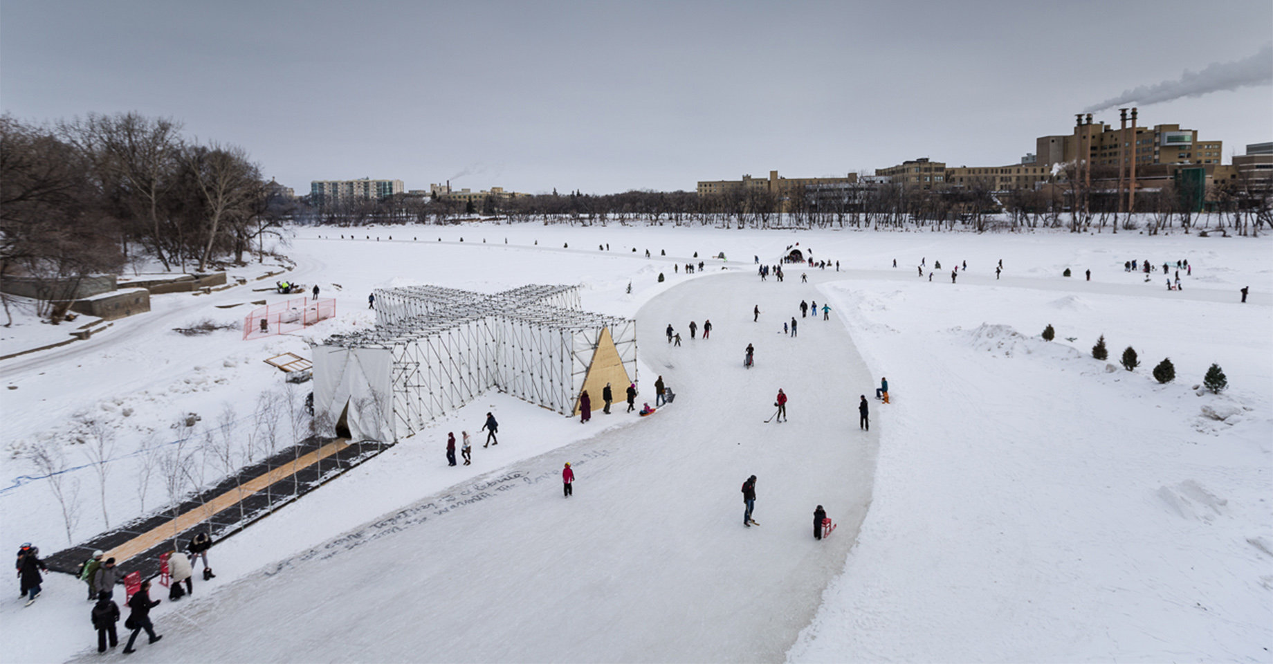 People gathering and playing on a frozen river